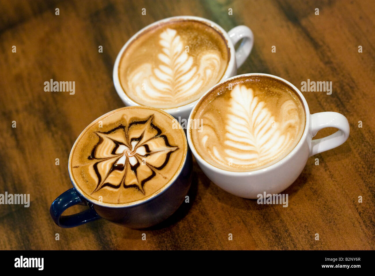 Cups with latte art by Barista s Daily Grind owner Ryan Dennhardt world champion of Ultimate Barista Challenge for - Stock Image