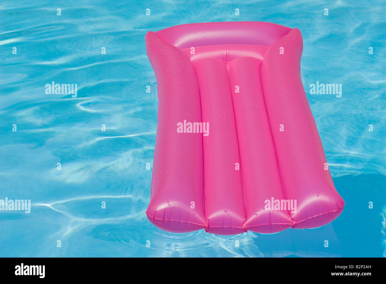 Pink inflatable chair floating in a swimming pool - Stock Image & Pink Inflatable Chair Stock Photos u0026 Pink Inflatable Chair Stock ...