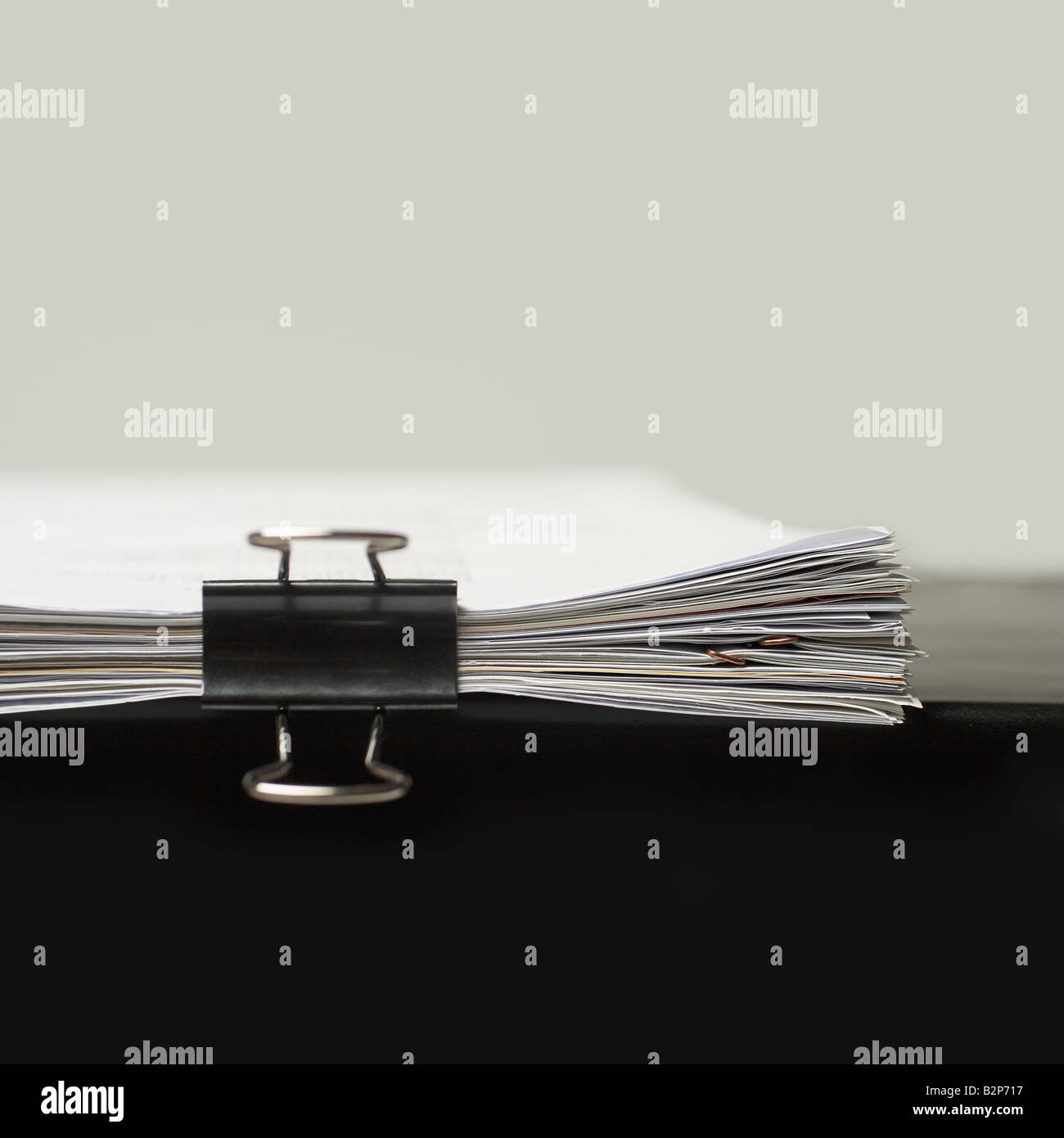 Stack of paperwork clipped together - Stock Image