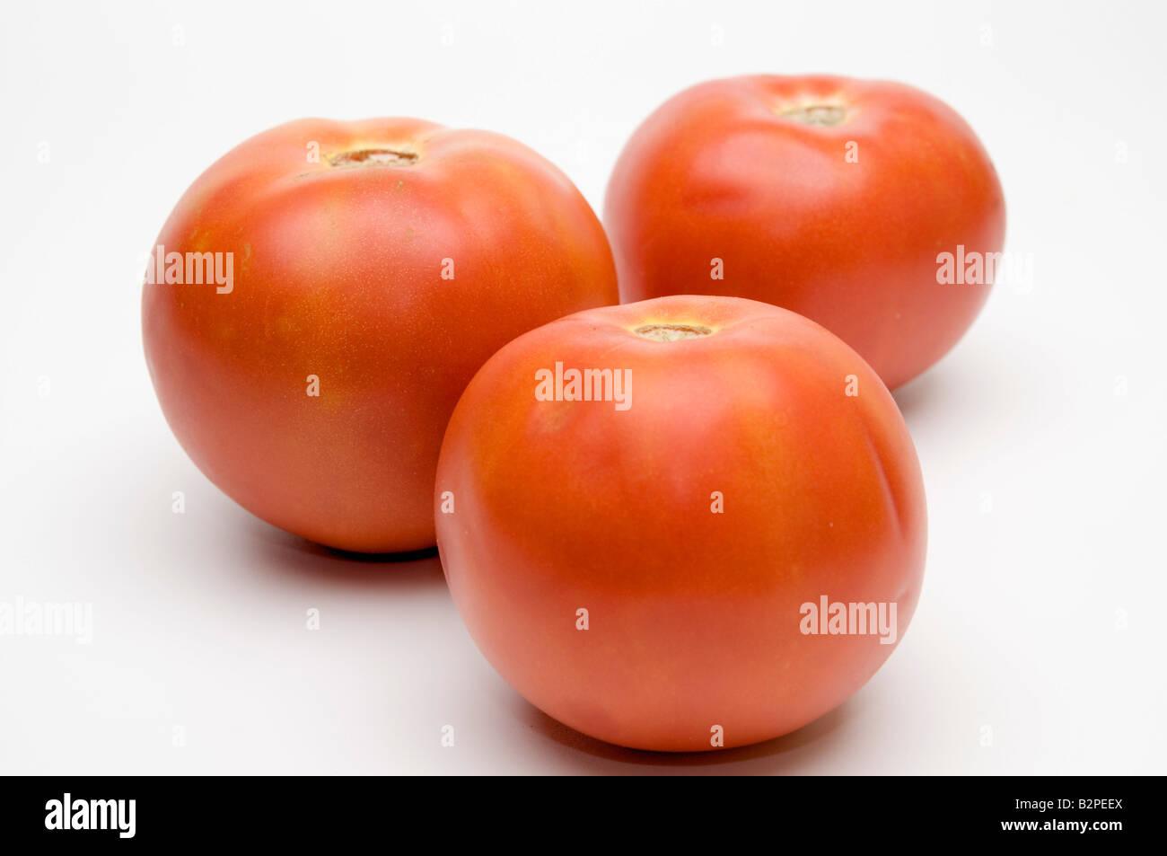 3 fresh ripe Red tomato on white background - Stock Image