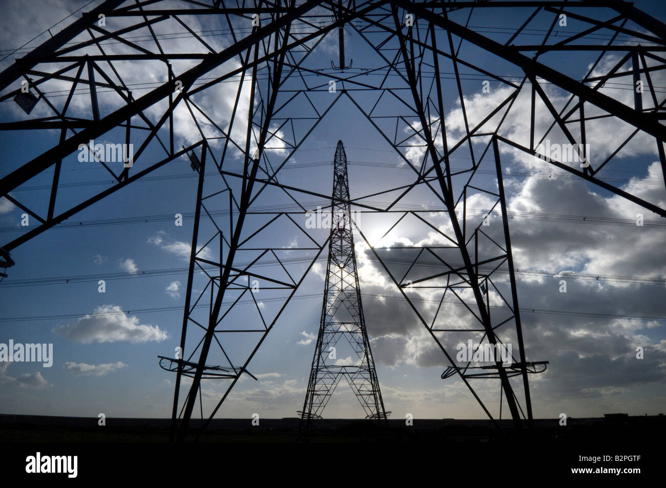 Electricity pylons carrying power from the British Energy Dungeness B Nuclear Power Station across the Kent countryside - Stock Image