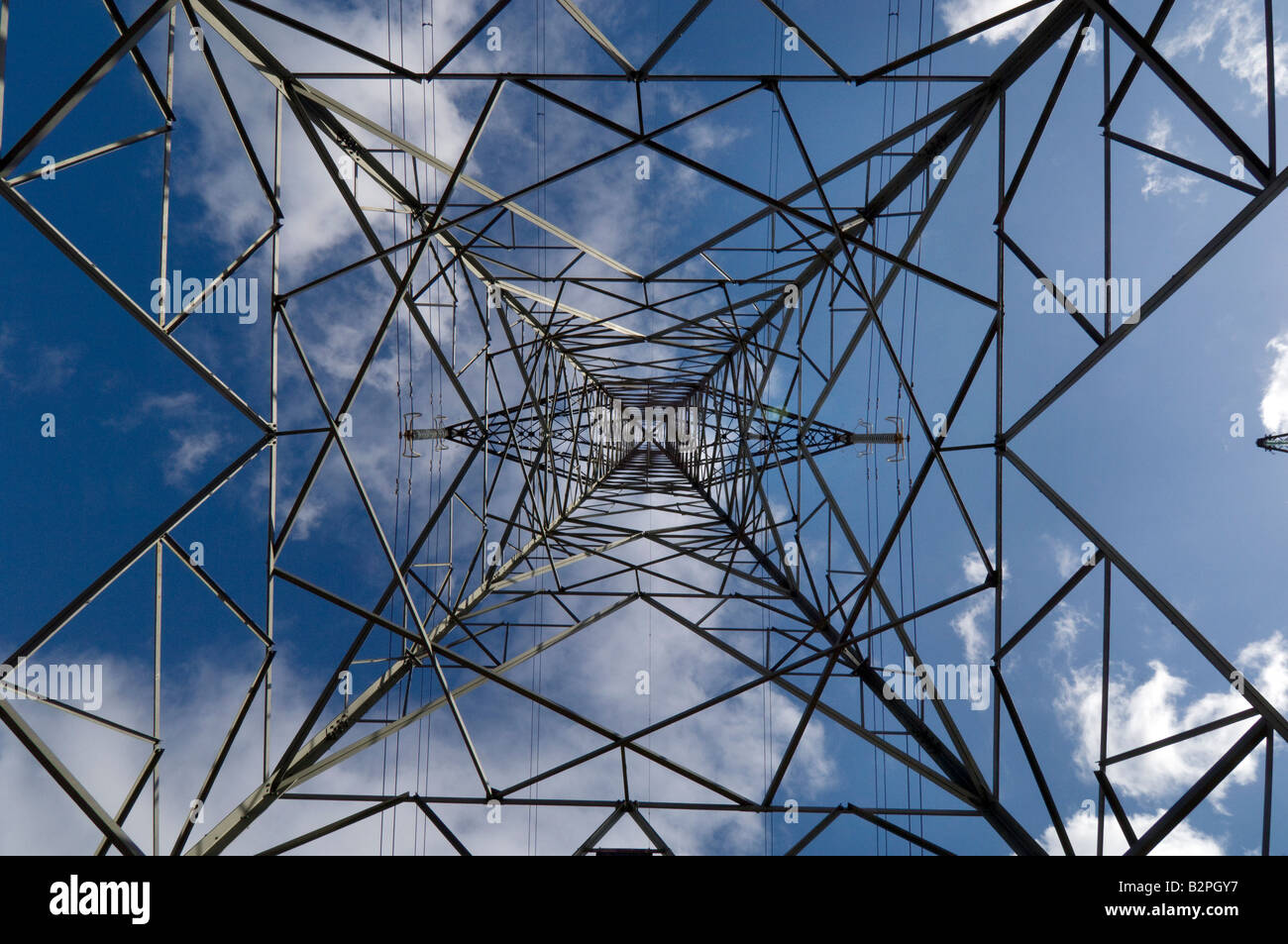 An electricity pylon carrying power from the British Energy Dungeness B Nuclear Power Station across the Kent countryside - Stock Image