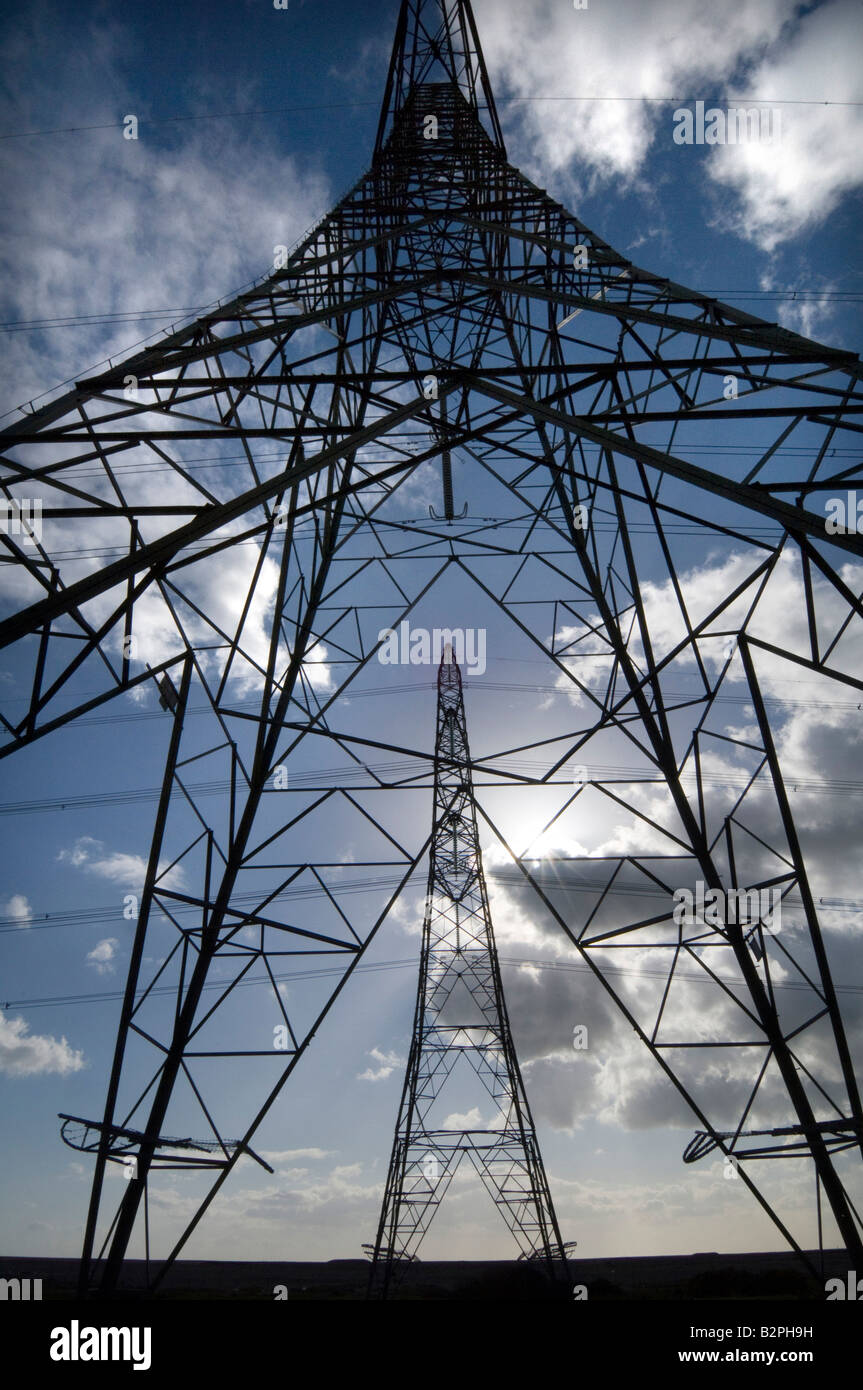 A row of electricity pylons - Stock Image