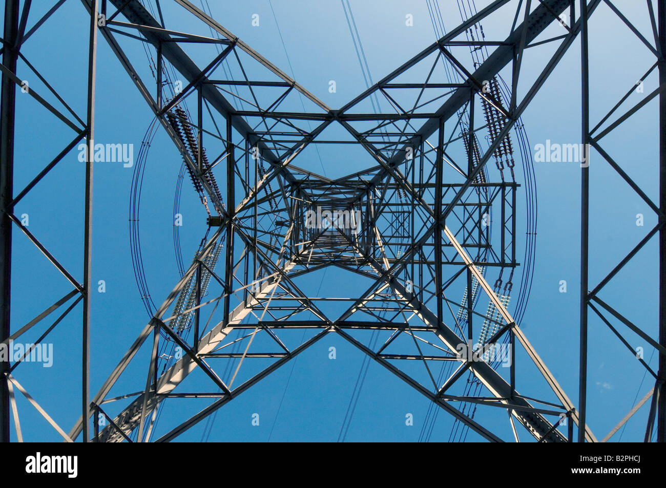 A low level view of an electricity pylon - Stock Image