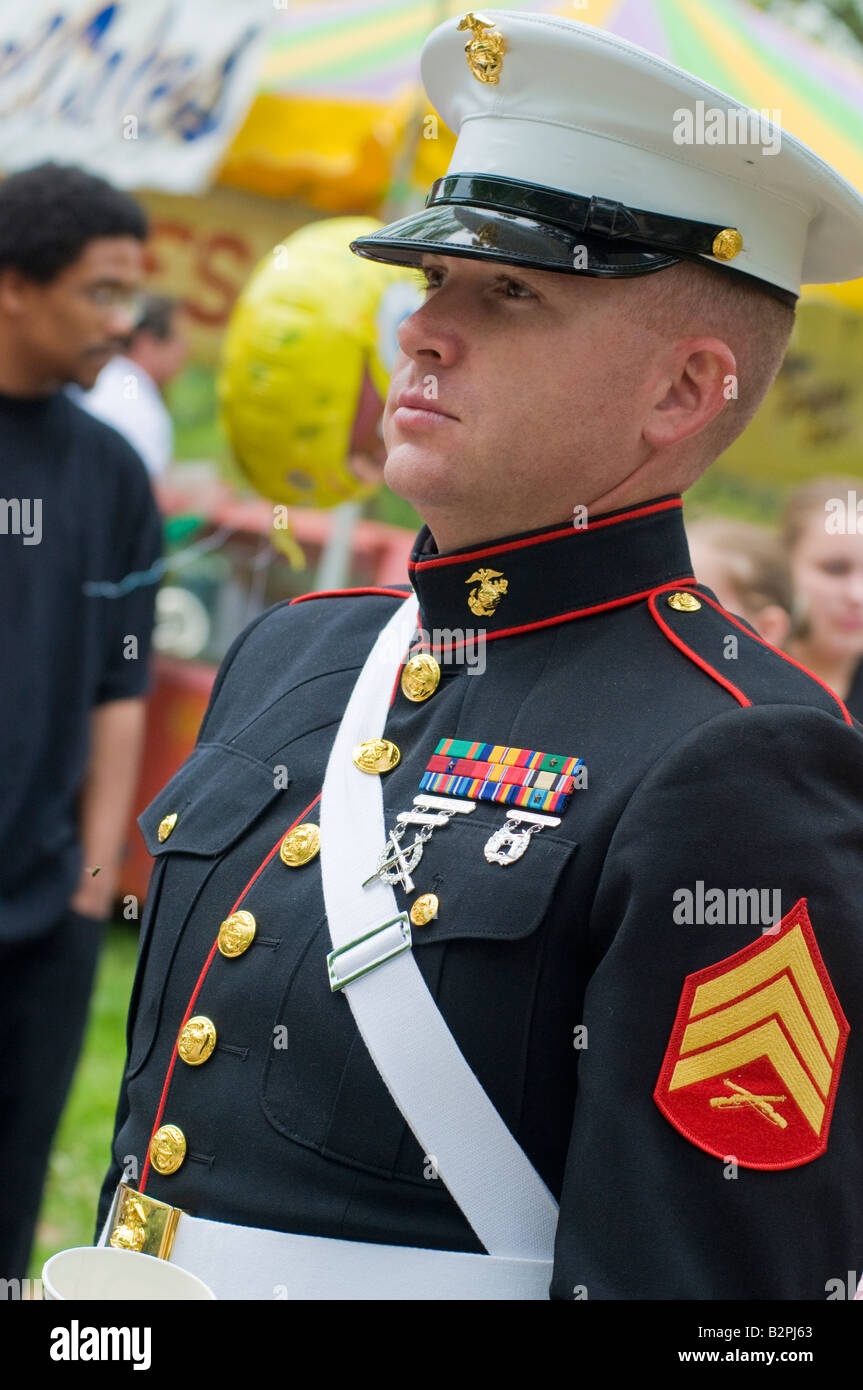 Loyalty day small town patriotic parade honoring military veterans past and present. US Marine band member - Stock Image