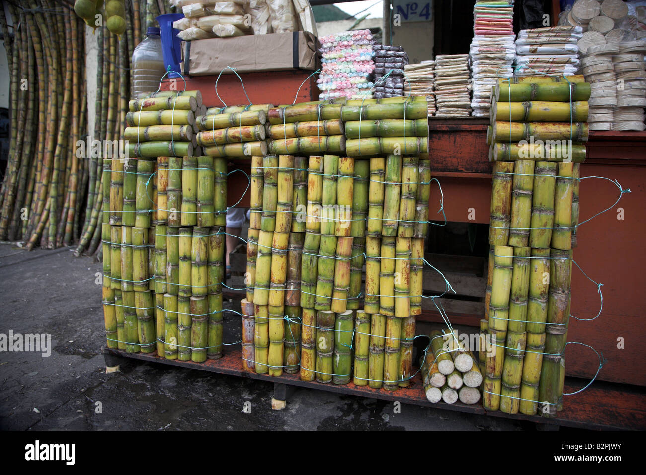 Raw Sugar Cane Sticks And Other Sweets On Sale In The Town