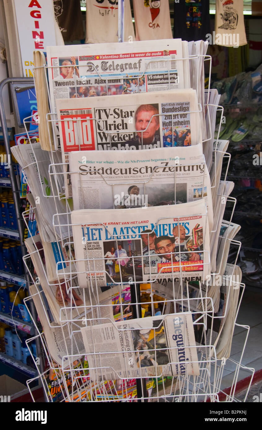 Newspapers on stand outside shop in Malia Old Town on the Greek Mediterranean island of Crete GR EU - Stock Image