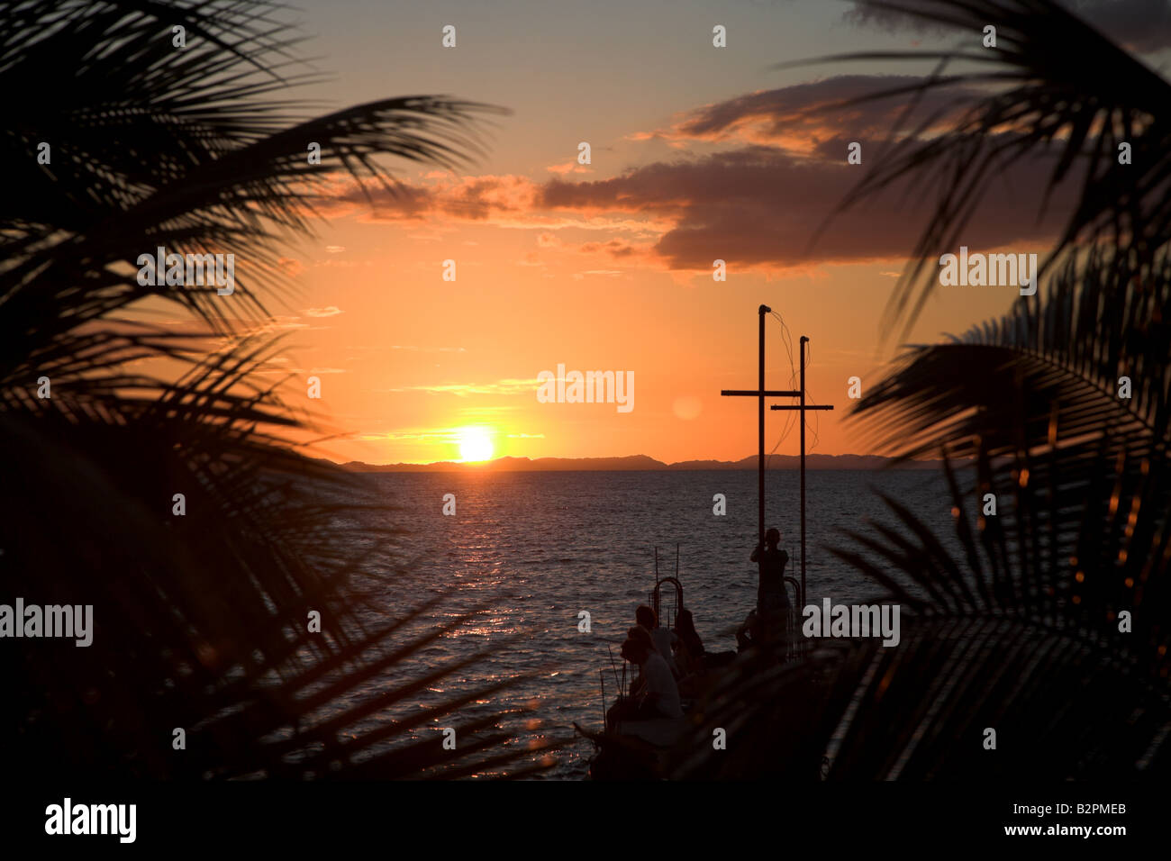The sunsets over a pier on Ometepe Island in Nicargua, Central America. Stock Photo