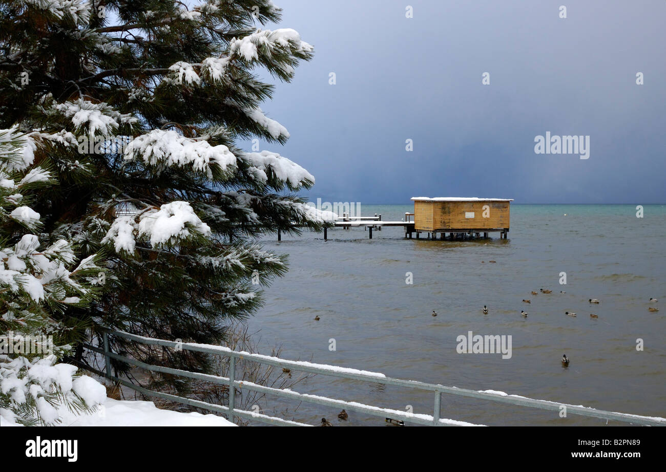 A storm is approaching on lake Tahoe in winter landscape version Mountains can be barely seen through the clouds Stock Photo