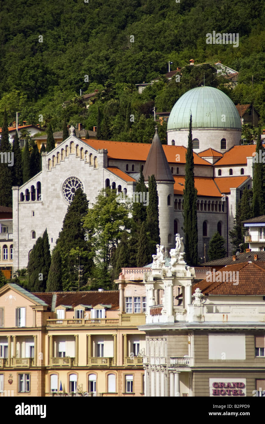Opatija Church of the Annunciation, above hotels fronting Adriatic Sea coast - Stock Image