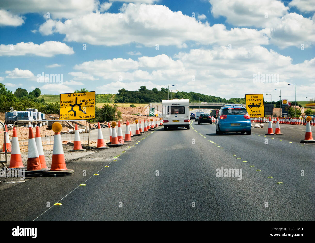 Holiday traffic in roadworks in summer, UK - Stock Image