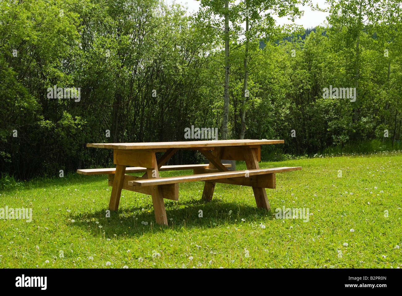 Picnic table next to a Canadian lake in Sun Peaks, Canada, British Columbia. - Stock Image
