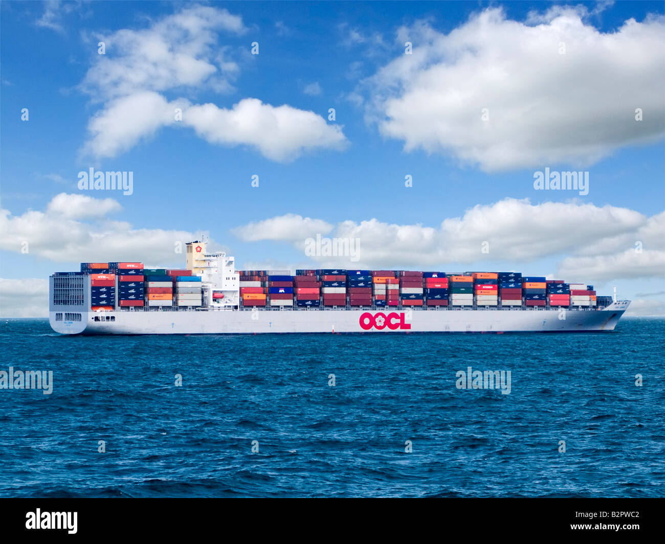 Container ship or cargo ship loaded with shipping containers sailing at sea ocean mid English Channel UK - Stock Image