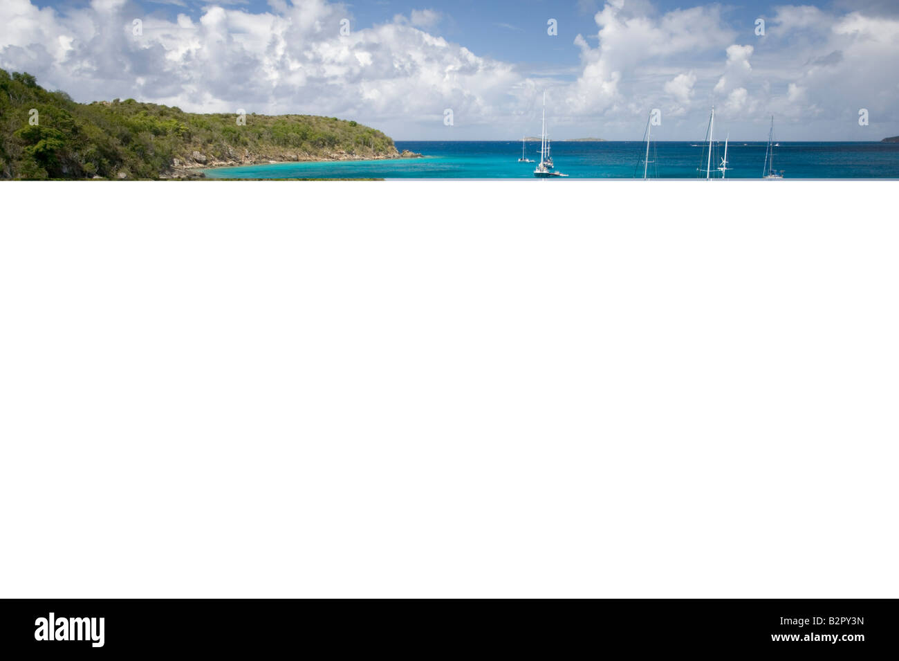 Cruising sailboats anchored at Christmas Cove Great St James Island St Thomas in the U S Virgin Islands - Stock Image