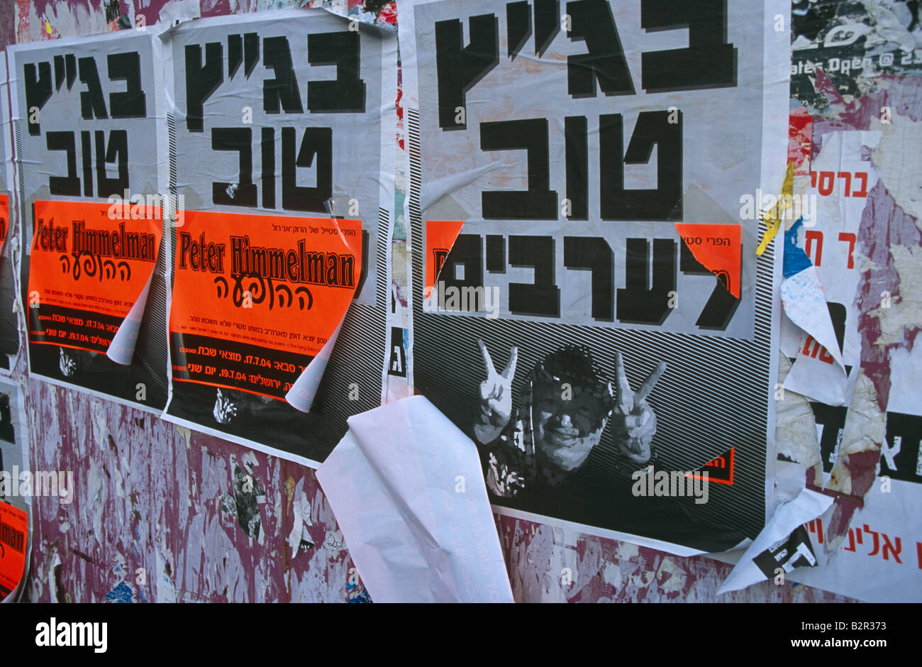 Posters in Hebrew language on wall, Jerusalem, Israel - Stock Image