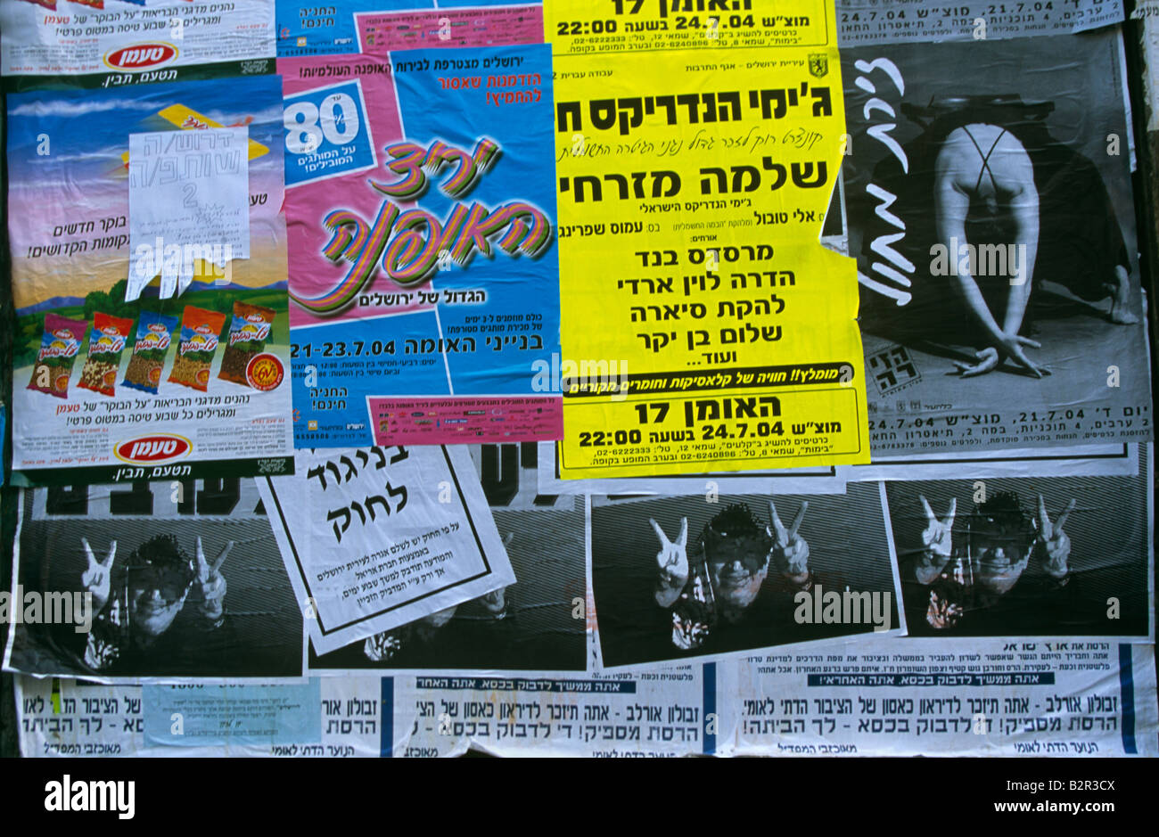 Posters and advertisements on wall, Israel - Stock Image
