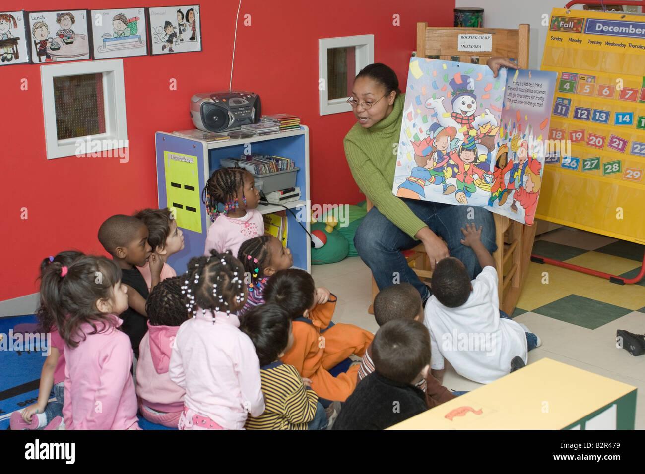 Preschool Teacher Reading A Book To Her Students