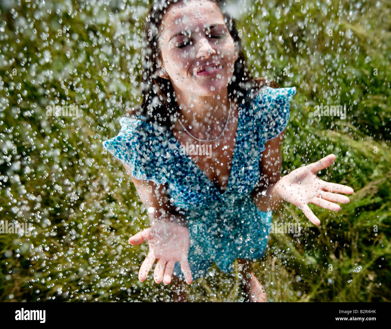 Woman standing in rain - Stock Image