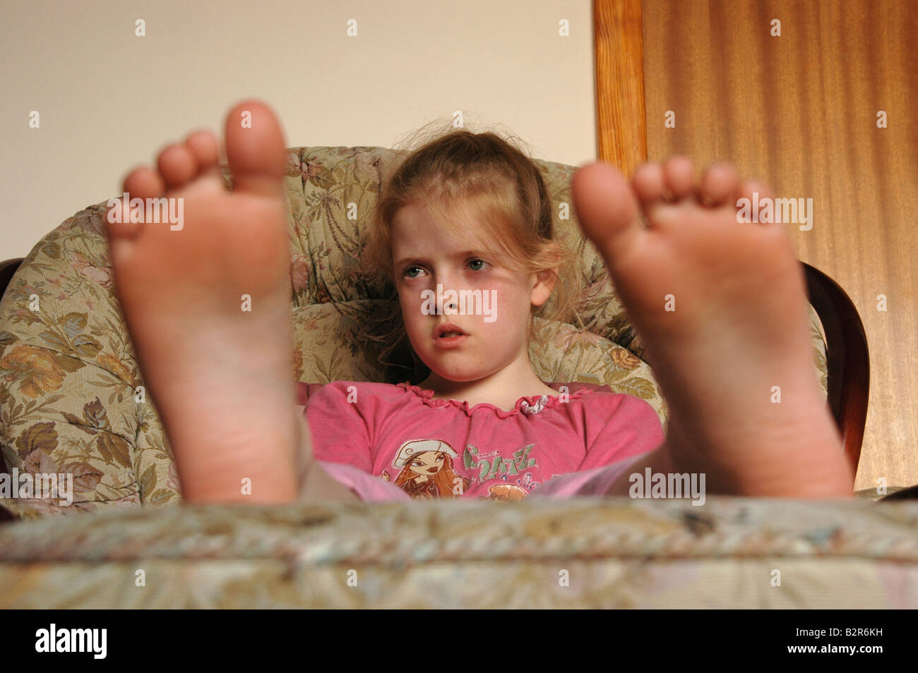 Blonde teen soles of feet