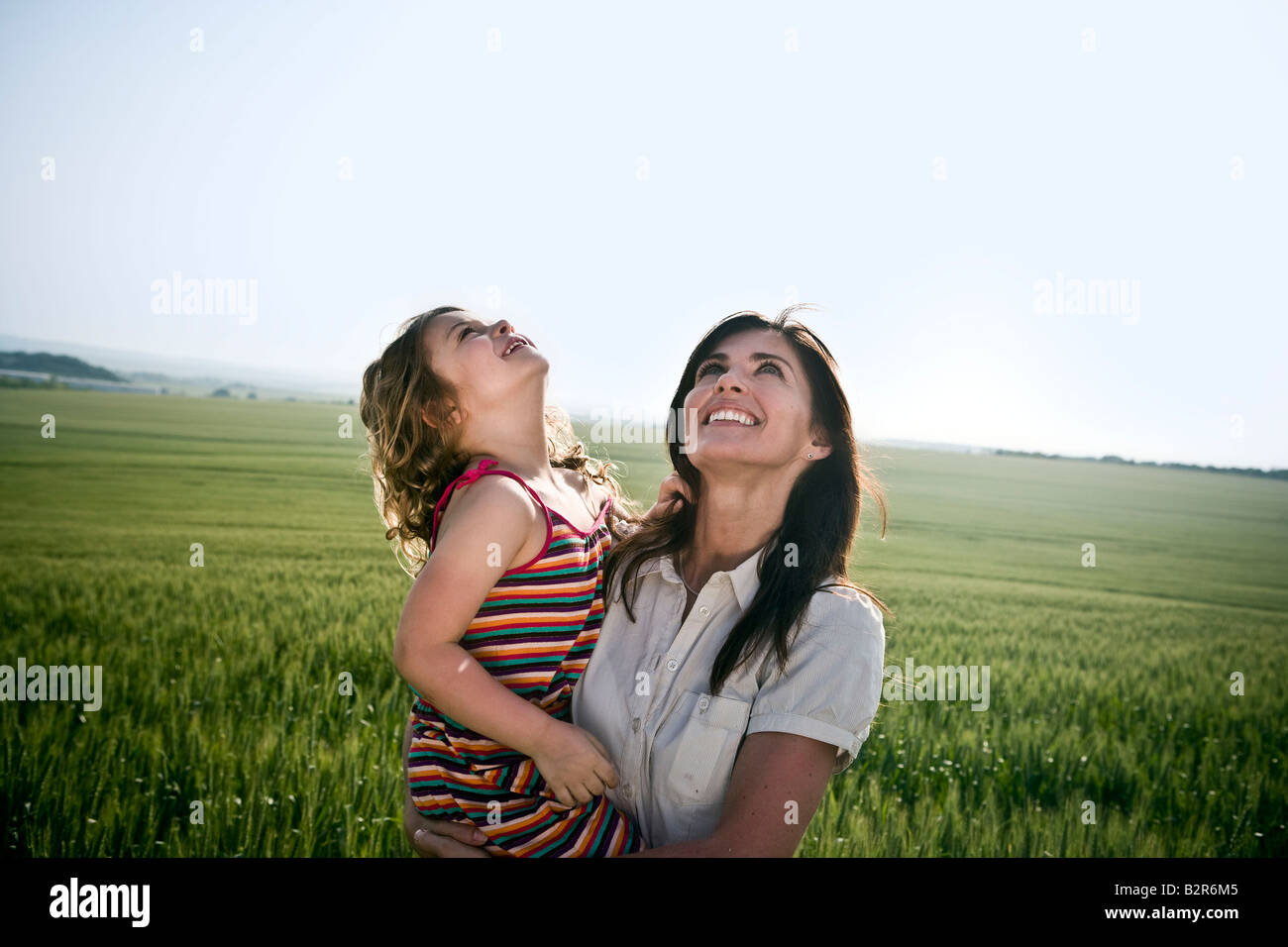 Woman and child looking at sky - Stock Image