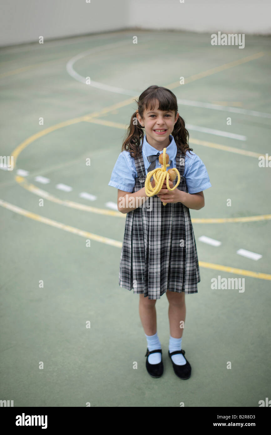 School girl holding skipping rope - Stock Image