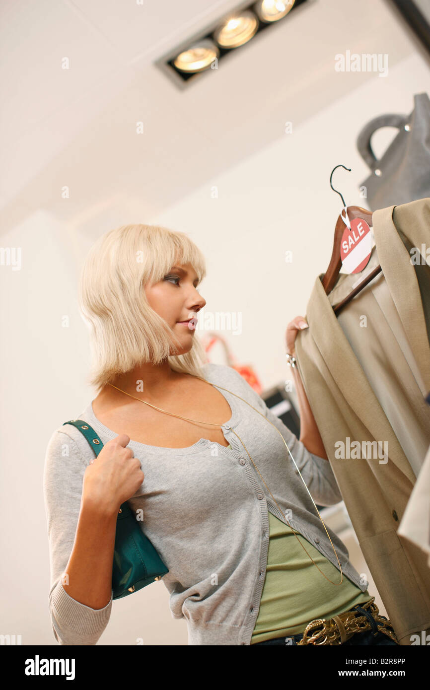 Young woman at clothes sale - Stock Image