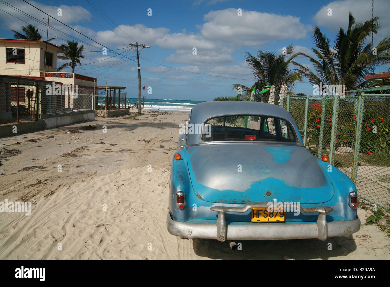 Vintage car parked in front of the Playas del Este Beach Havanna Province Cuba Latin America - Stock Image