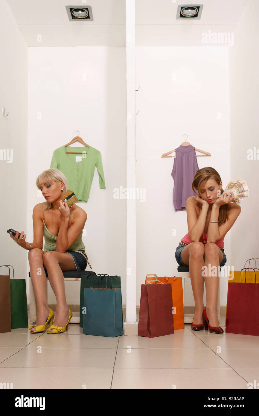 Young women with credit cards and cash - Stock Image