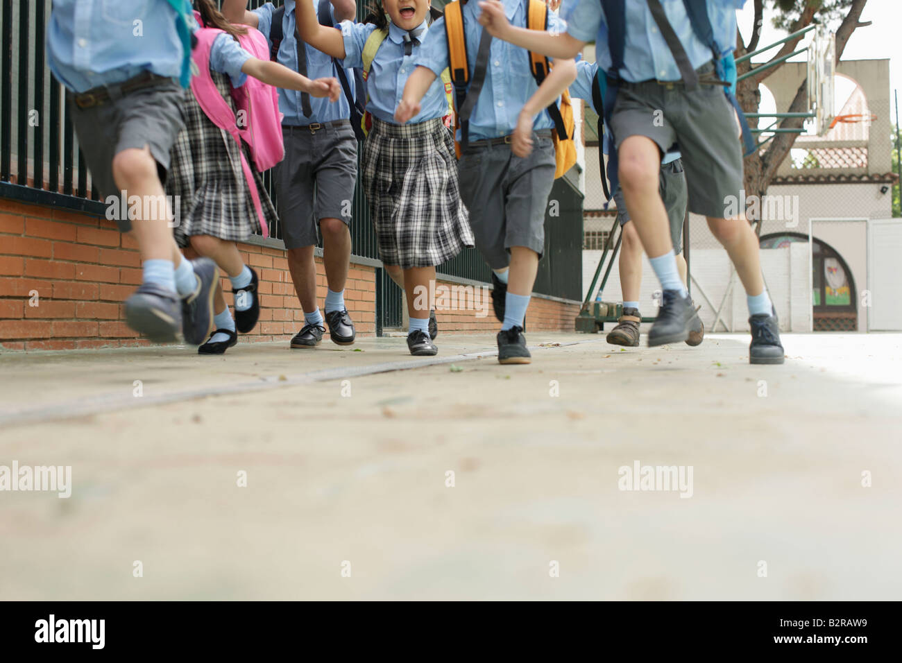 School children running low angle - Stock Image