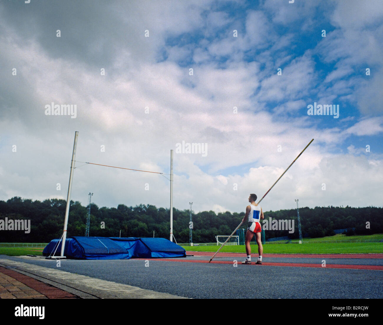 Pole vaulter preparing for event. - Stock Image
