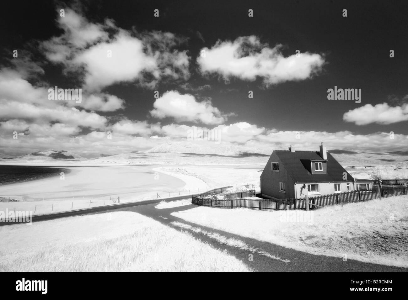 Infrared image of a house next to Seilebost beach, Isle of Harris, Hebrides, Scotland, UK - Stock Image