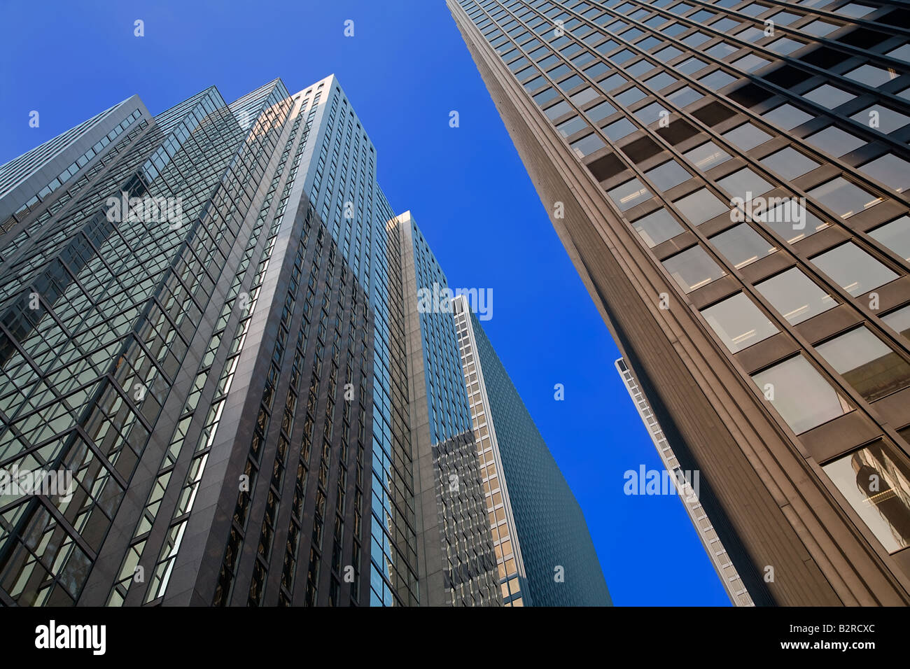 A view of skyscrapers while looking up from the street Stock Photo