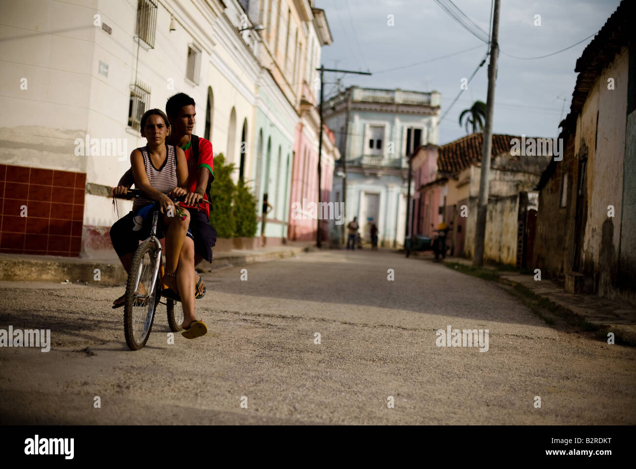 Couple of teenagers riding a bicycle in Remedios, Cuba - Stock Image