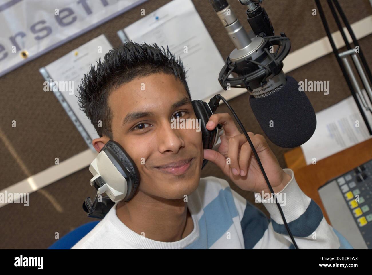 Young asian boy DJing - Stock Image