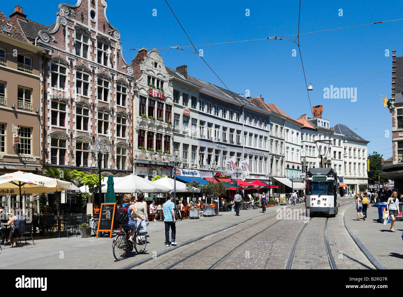 Tram and Cafe on the Korenmarkt in the historic city centre, Ghent, Belgium - Stock Image