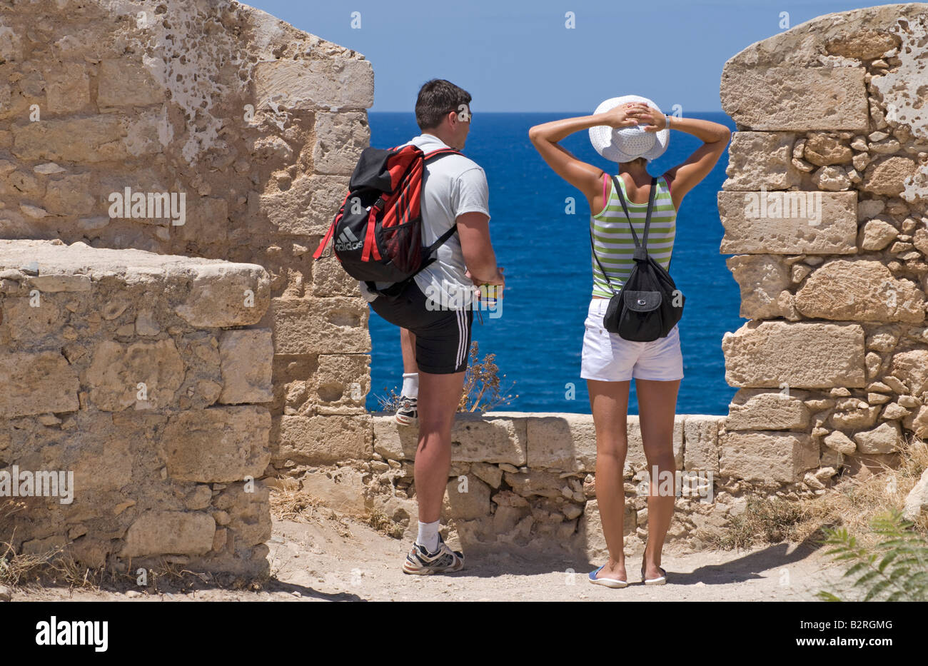 Rethymno, Crete, Greece. 16thC Fortress (Fortezza) Young couple looking out to sea Stock Photo