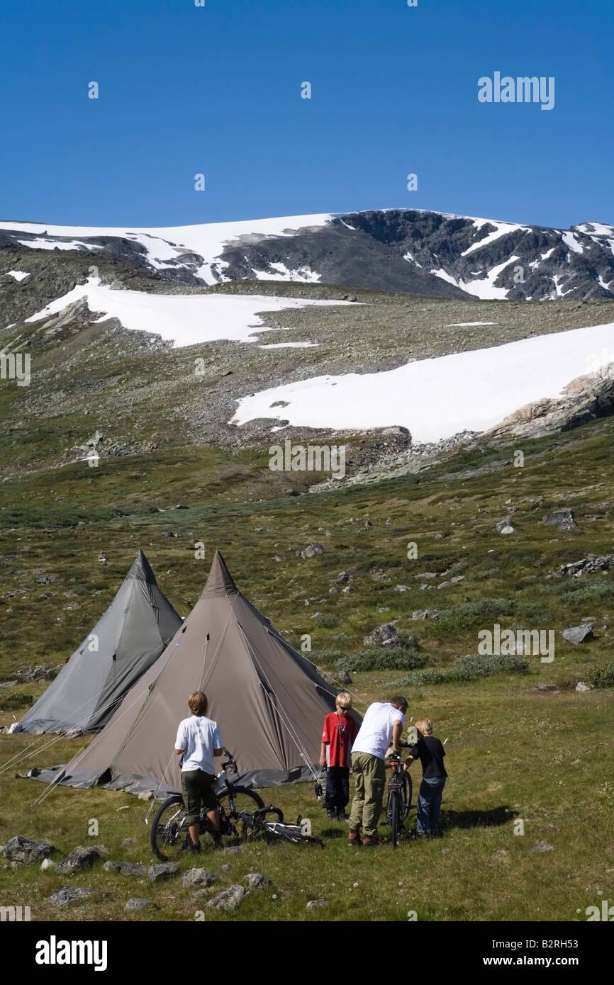 Norway Glittertind Laplander s tents and hikers bikers summer 2008 - Stock Image