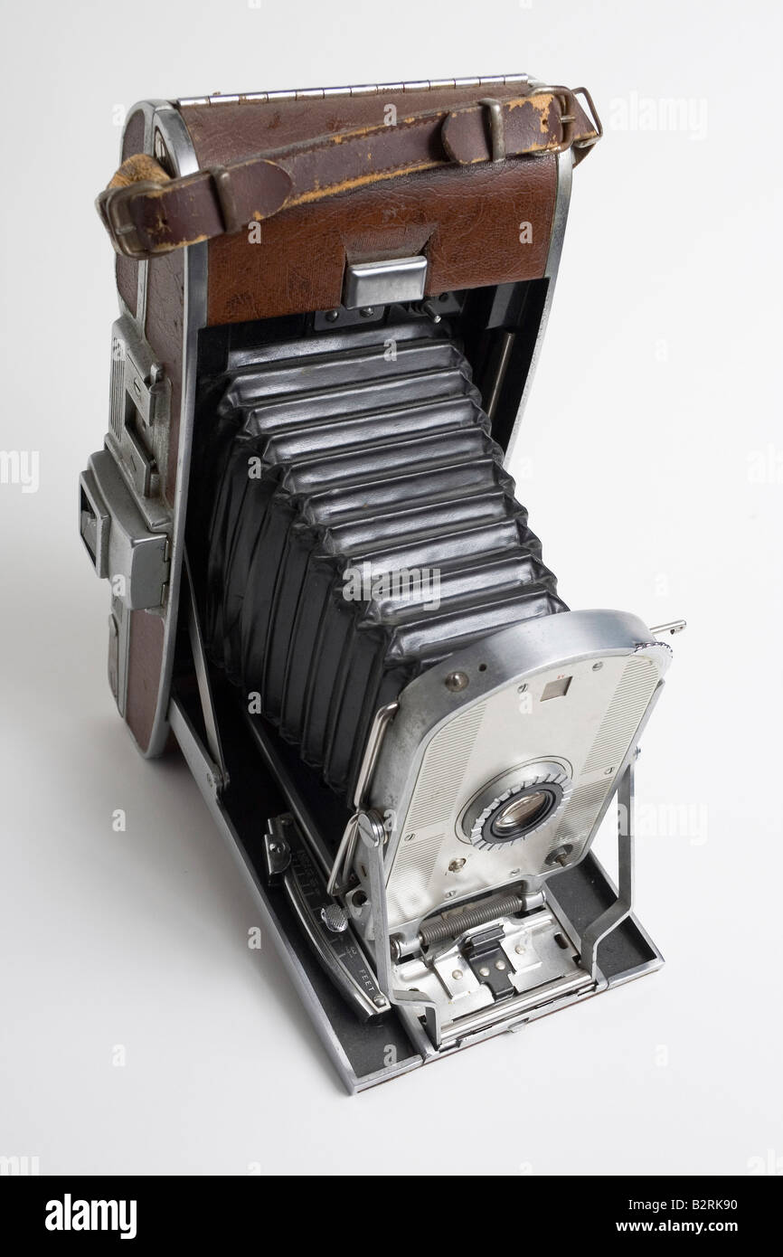 Old fashion antique Polaroid camera with bellows in brown leather casing - Stock Image