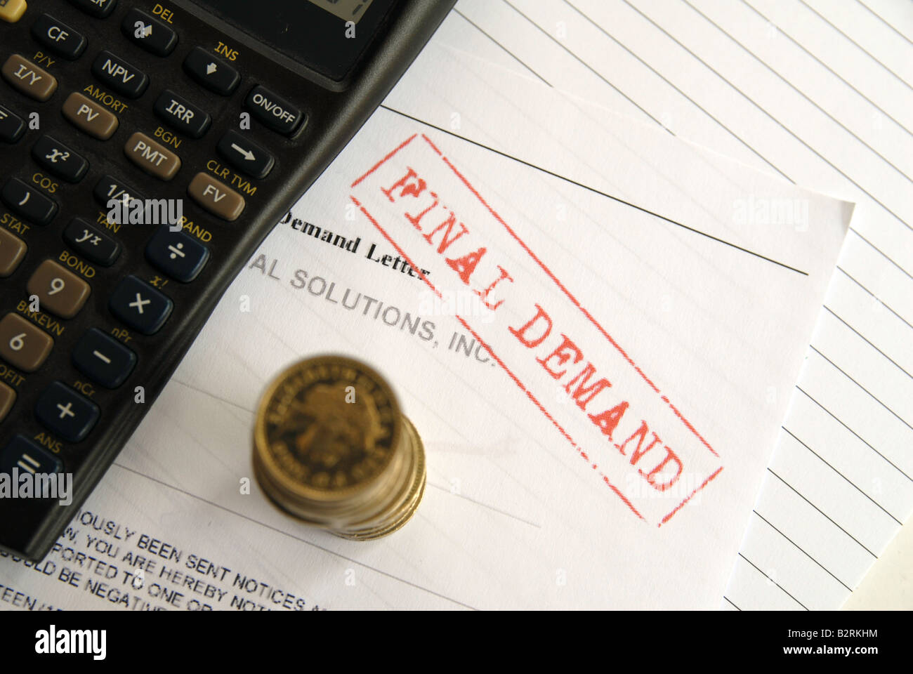 Doing the sums to pay a final demand bill final demand - Stock Image