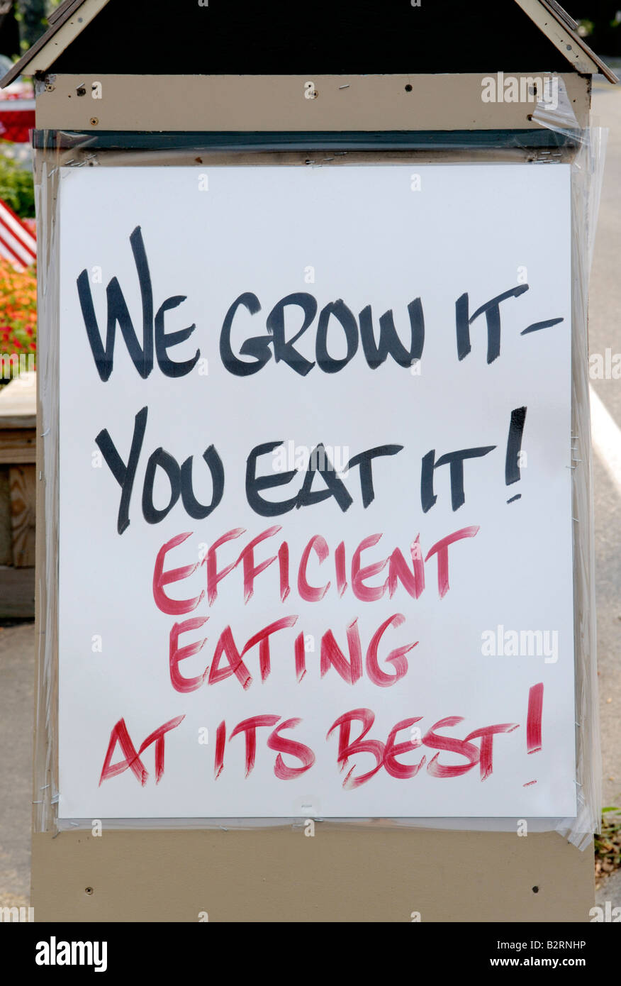 Sign announcing that the produce for sale is locally grown - Stock Image