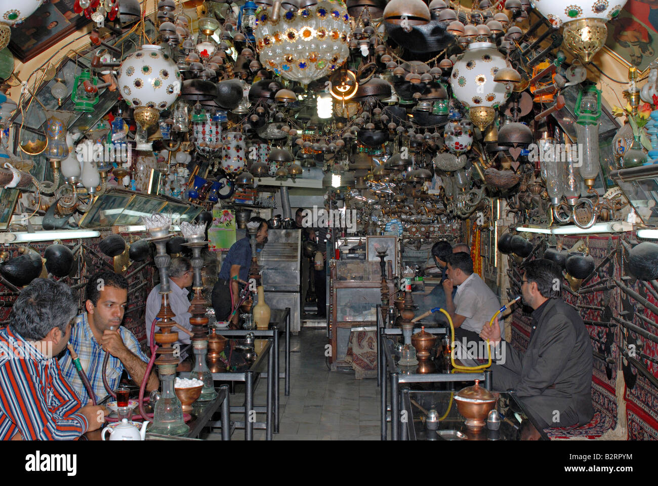 Iran Esfahan -  A tea shop in which old art objects displayed for decoration (Hukkah) hookah - Stock Image