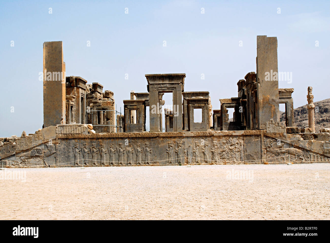 Iran Persepolis Remains Of Palace Complex With Warriors On Plinth Stock Photo Alamy