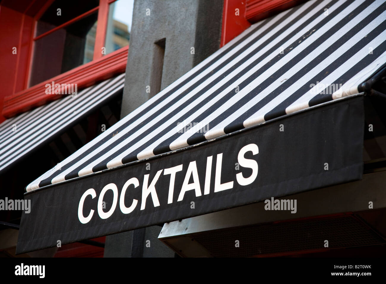Cocktail display sign on striped black and white window canopy Gaslamp historic area of San Diego, California, USA - Stock Image