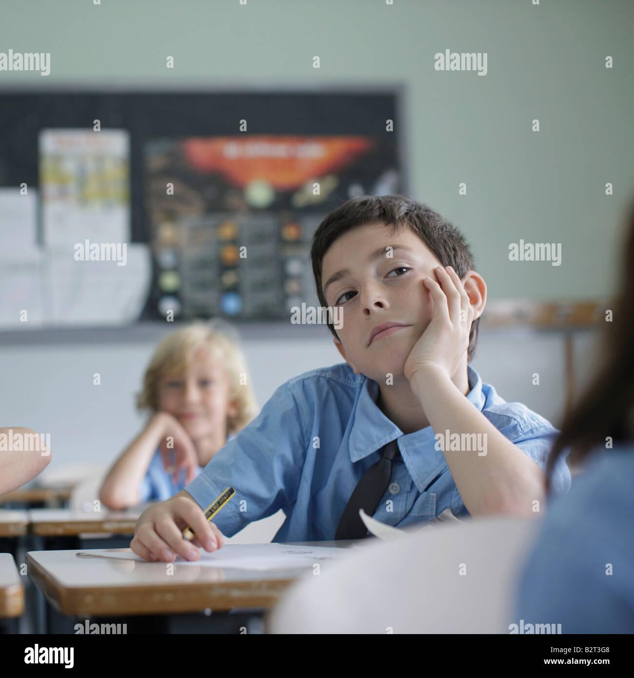 School boy listening in class - Stock Image