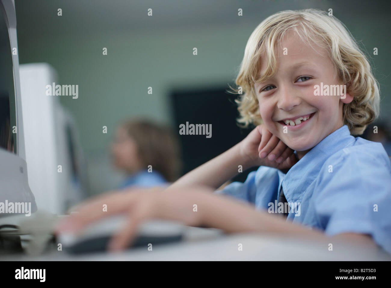 School boy at computer - Stock Image