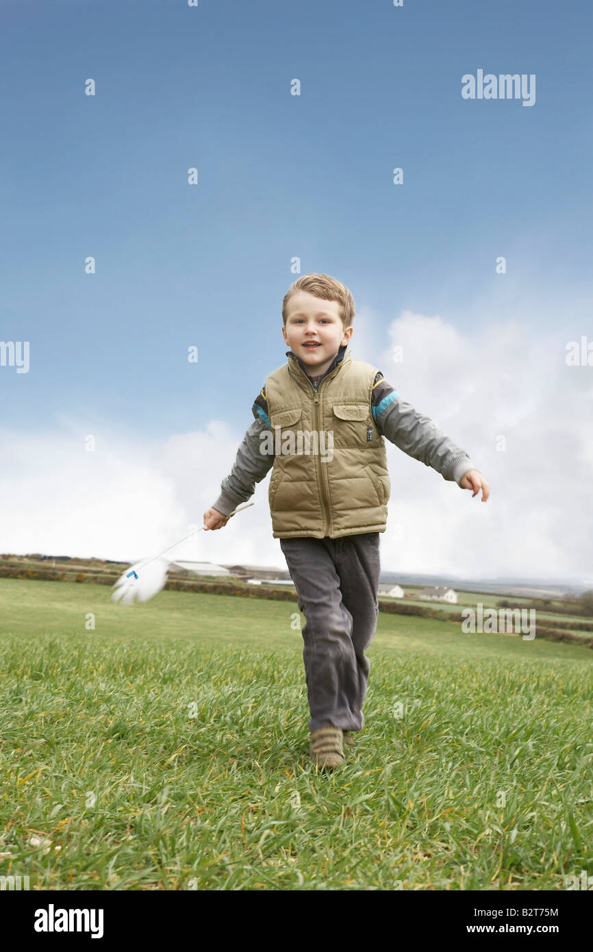 Boy running with windmill - Stock Image