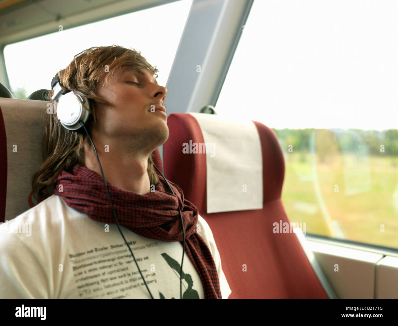 Young man on train - Stock Image