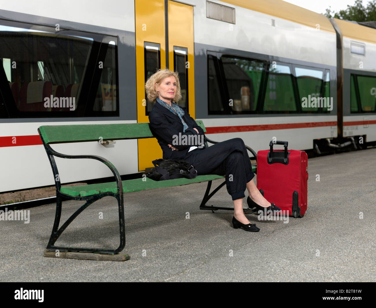 Mature woman on train station - Stock Image