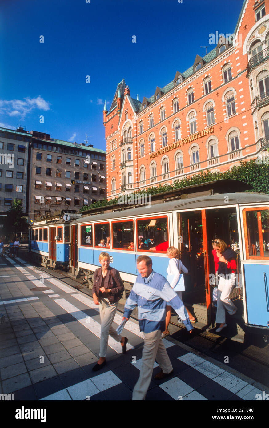 Passengers getting off streetcar at Normalmstorg in downtown Stockholm - Stock Image