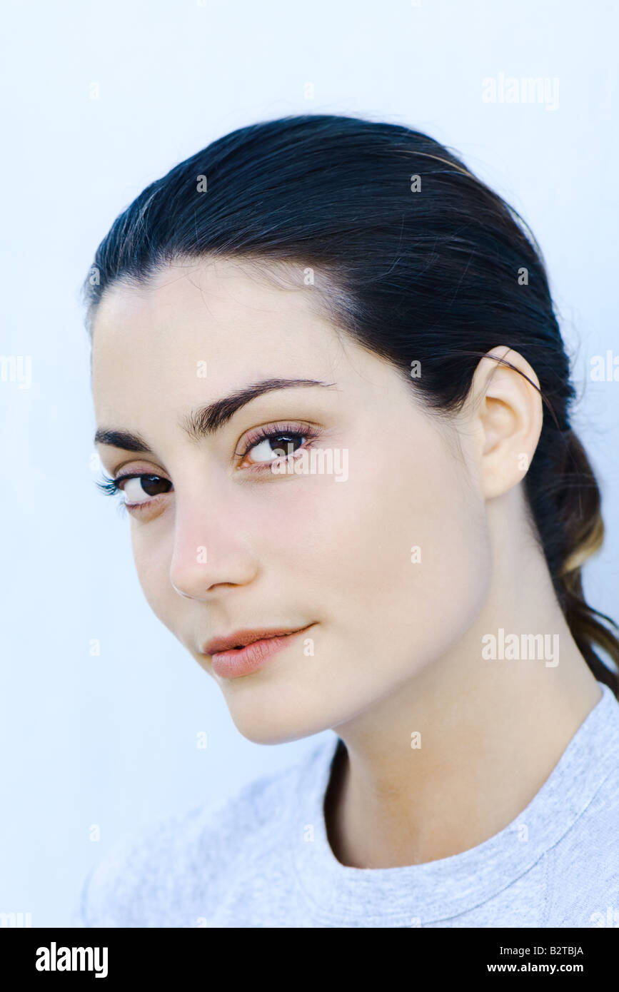Woman looking at camera, portrait - Stock Image
